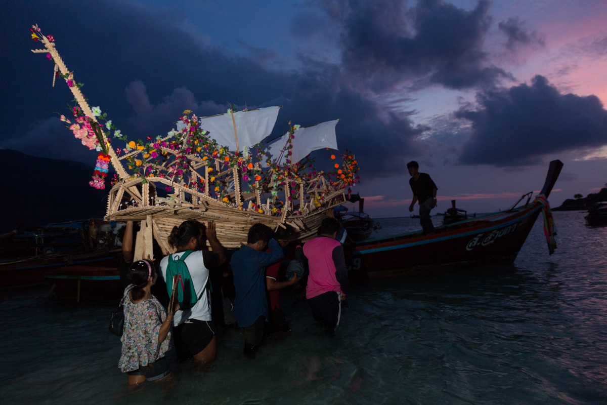 carrying the ceremonial boat